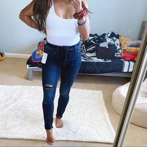 Super stretch ripped dark denim skinny jeans